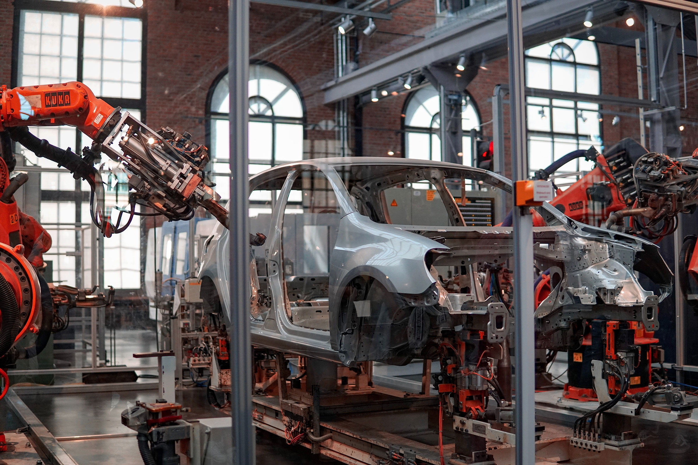Photo of a car being put together by robotic arms